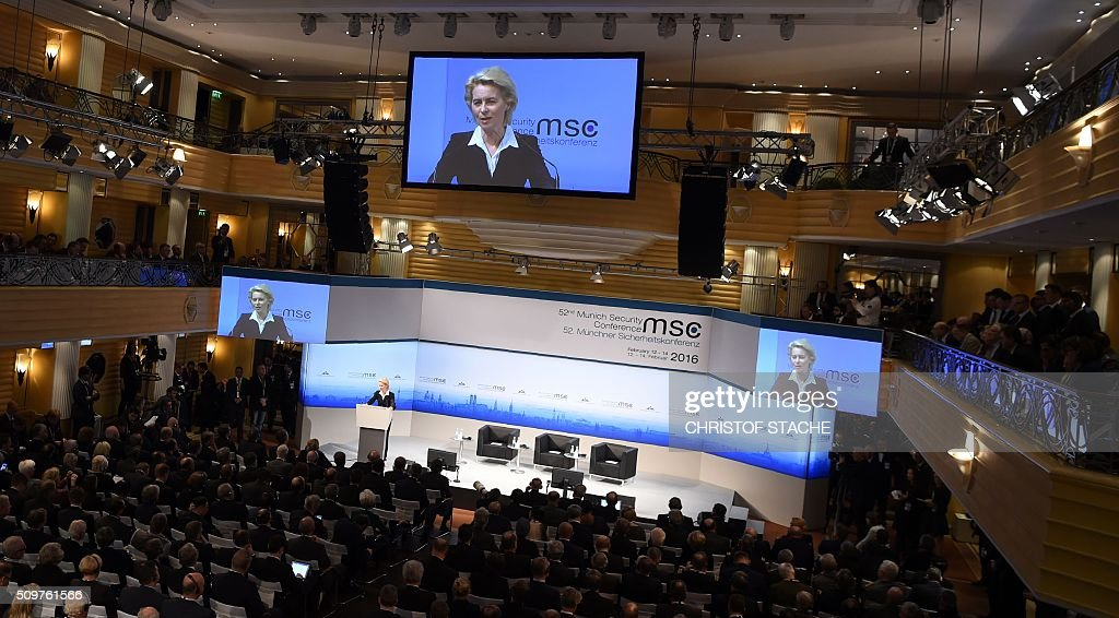 German Defence Minister Ursula von der Leyen is displayed on a giant screen as she gives a speech to open the 52nd Munich Security Conference (MSC) in Munich, southern Germany, on February 12, 2016. The Munich Security Conference takes place here until February 14, 2016. / AFP / Christof Stache