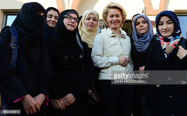 German Defence Minister Ursula von der Leyen poses with female Balkh University students following a discussion with them at the German consulate in...