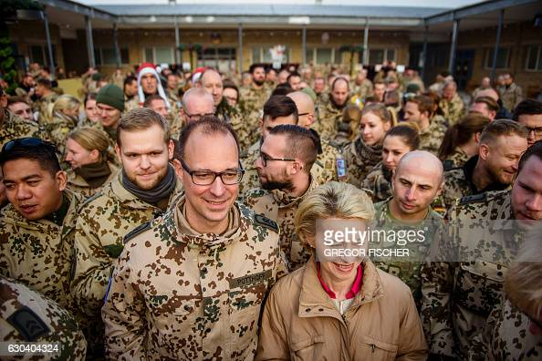 German Defence Minister Ursula von der Leyen poses with German soldiers as she visits German soldiers at Camp Marmal in MazariSharif northern...