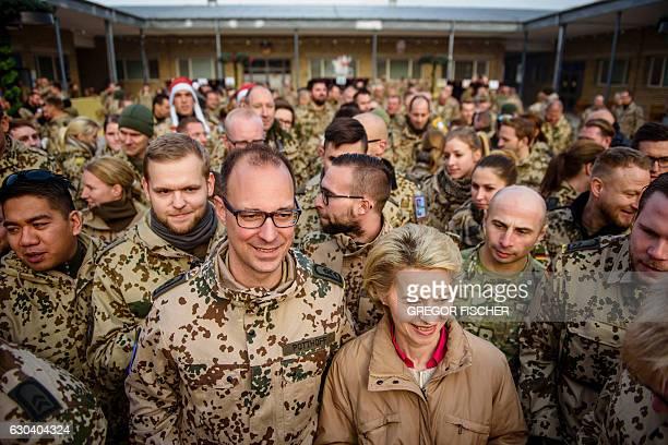 German Defence Minister Ursula von der Leyen poses with German soldiers as she visits German soldiers at Camp Marmal in MazariSharif northern...