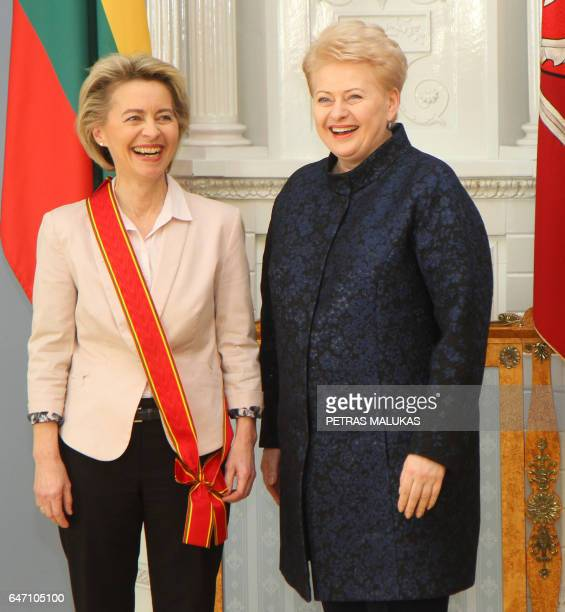 German Defence Minister Ursula von der Leyen reacts beside Lithuania's President Dalia Grybauskaite after receiving the Grand Cross of the Order for...