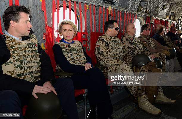 German Defence Minister Ursula von der Leyen sits in a US Air Force helicopter on her way from ISAF headquarters to Kabul airport on December 14 2014...