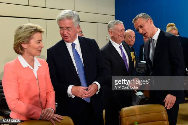 German Defence Minister Ursula von der Leyen talks with Britain's Defence Minister Michael Fallon as US Defence Minister James Mattis shakes hands...