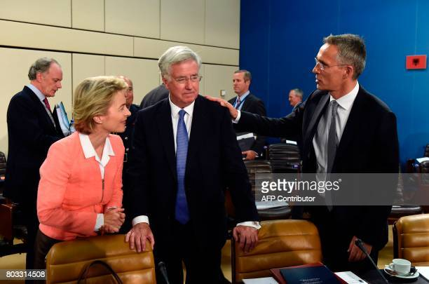 German Defence Minister Ursula von der Leyen talks with Britain's Defence Minister Michael Fallon and NATO SecretaryGeneral Jens Stoltenberg during a...