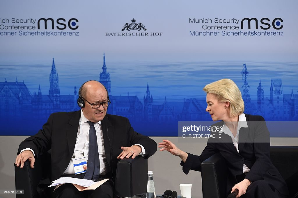 German Defence Minister Ursula von der Leyen talks with her French counterpart Jean-Yves Le Drian during the 52nd Munich Security Conference (MSC) in Munich, southern Germany, on February 12, 2016. The Munich Security Conference takes place here until February 14, 2016. / AFP / Christof Stache