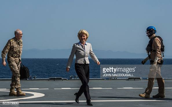 German Defence Minister Ursula von der Leyen walks along the landing pad after landing on the German navy support ship Bonn in the Aegean Sea off the...