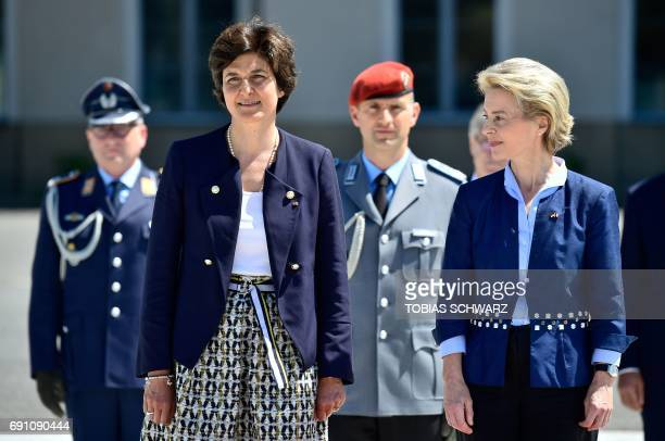 German Defence Minister Ursula von der Leyen welcomes her new French counterpart Sylvie Goulard at the Defence Ministry in Berlin on June 1 2017 /...