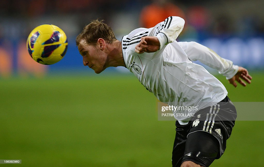 German defender Benedikt Hoewedes heads the ball during the friendly football match Netherlands vs Germany on November 14, 2012 in Amsterdam.