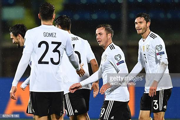 German defender Jonas Hector celebrates with teammates after scoring a goal during the World Cup 2018 qualifying football match between San Marino...