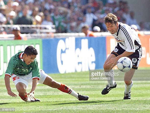 German defender Lothar Matthaus is challenged by Mexican Jesus Arellano 29 June at the Stade de la Mosson in Montpellier south of France during the...