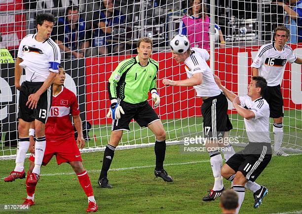 German defender Per Mertesacker deflects a ball next to German goalkeeper Jens Lehmann German midfielder Michael Ballack Turkish midfielder Kazim...