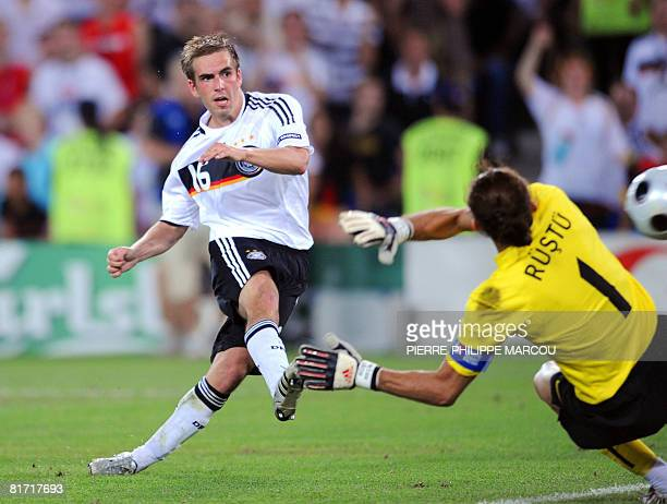 German defender Philipp Lahm scores the third goal past Turkish goalkeeper Rustu Recber during the Euro 2008 championships semifinal football match...