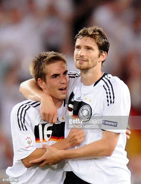 German defenders Philipp Lahm and Arne Friedrich celebrate after midfielder teammate Michael Ballack scored their team's third goal during the Euro...
