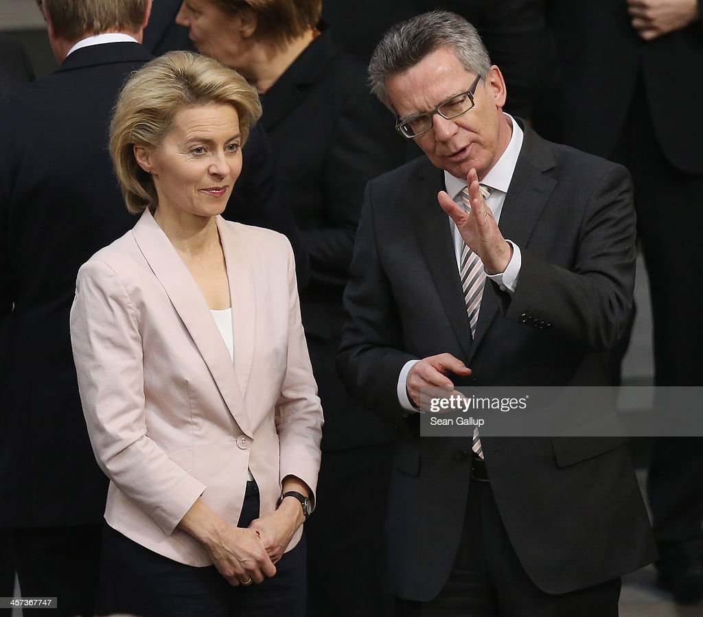 German Defense Minister designate Ursula von der Leyen (L) talks with outgoing Defense Minister Thomas de Maiziere shortly before she was scheduled to attend her appointment ceremony at the Defense Ministery prior to ceremonies in which the new German government will be sworn in on December 17, 2013 in Berlin, Germany. The new government is a coalition between the German Christian Democrats (CDU), the Bavarian Christian Democrats (CSU) and German Social Democrats (SPD) following federal elections held in September.