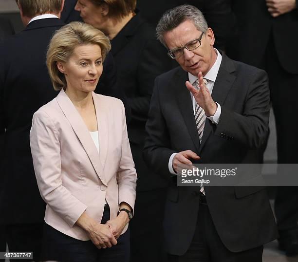 German Defense Minister designate Ursula von der Leyen talks with outgoing Defense Minister Thomas de Maiziere shortly before she was scheduled to...