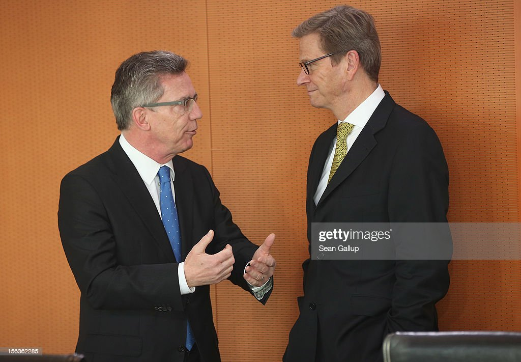 German Defense Minister <a gi-track='captionPersonalityLinkClicked' href=/galleries/search?phrase=Thomas+de+Maiziere&family=editorial&specificpeople=618845 ng-click='$event.stopPropagation()'>Thomas de Maiziere</a> (L) and Foreign Minister <a gi-track='captionPersonalityLinkClicked' href=/galleries/search?phrase=Guido+Westerwelle&family=editorial&specificpeople=208748 ng-click='$event.stopPropagation()'>Guido Westerwelle</a> chat upon their arrival at the German government weekly cabinet meeting on November 14, 2012 in Berlin, Germany. High on the morning's agenda is the annual weapons export report (Ruestungsexportbericht 2011).