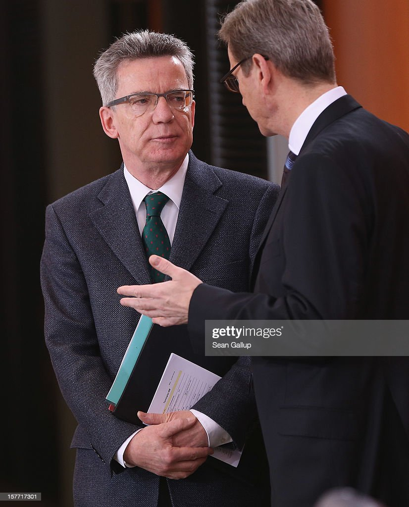 German Defense Minister <a gi-track='captionPersonalityLinkClicked' href=/galleries/search?phrase=Thomas+de+Maiziere&family=editorial&specificpeople=618845 ng-click='$event.stopPropagation()'>Thomas de Maiziere</a> (L) and Foreign Minister <a gi-track='captionPersonalityLinkClicked' href=/galleries/search?phrase=Guido+Westerwelle&family=editorial&specificpeople=208748 ng-click='$event.stopPropagation()'>Guido Westerwelle</a> arrive for the weekly German government cabinet meeting on December 6, 2012 in Berlin, Germany. The German and Israeli governments are meeting later in the day for German-Israeli government consultations.