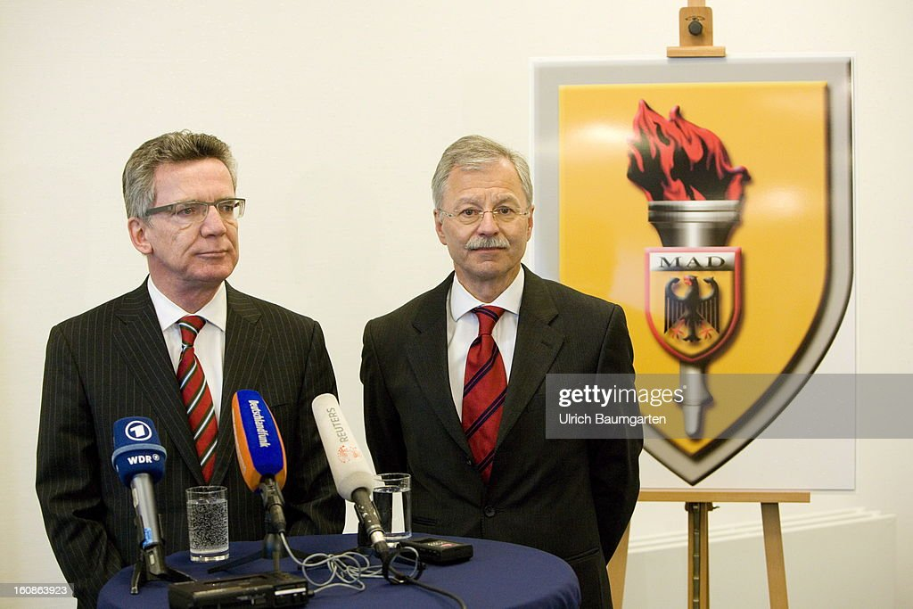German Defense Minister <a gi-track='captionPersonalityLinkClicked' href=/galleries/search?phrase=Thomas+de+Maiziere&family=editorial&specificpeople=618845 ng-click='$event.stopPropagation()'>Thomas de Maiziere</a> (left), and Ulrich Birkenheier, President of the MAD, at the ministers visit the German Military Counter-Intelligence Service (MAD) on February 6, 2013 in Cologne, Germany. Defense Minister <a gi-track='captionPersonalityLinkClicked' href=/galleries/search?phrase=Thomas+de+Maiziere&family=editorial&specificpeople=618845 ng-click='$event.stopPropagation()'>Thomas de Maiziere</a> has rejected calls to shut down the Counter-Intelligence Agency despite fierce criticism from Ministers, following an investigation carried out by the Bundestag, for withholding information surrounding their recruitment of the NSU neo-Nazi terrorist Uwe Mundlos.