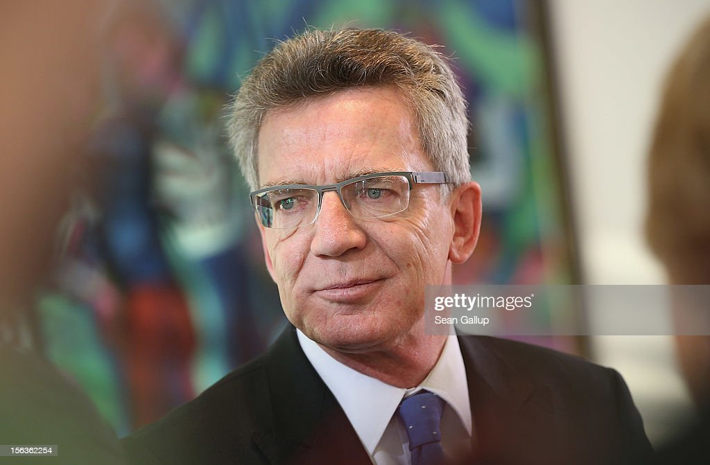 German Defense Minister <a gi-track='captionPersonalityLinkClicked' href=/galleries/search?phrase=Thomas+de+Maiziere&family=editorial&specificpeople=618845 ng-click='$event.stopPropagation()'>Thomas de Maiziere</a> arrives at the German government weekly cabinet meeting on November 14, 2012 in Berlin, Germany. High on the morning's agenda is the annual weapons export report (Ruestungsexportbericht 2011).