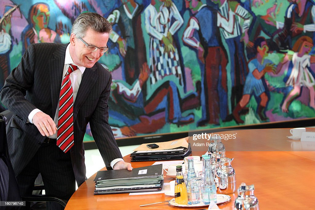 German Defense Minister <a gi-track='captionPersonalityLinkClicked' href=/galleries/search?phrase=Thomas+de+Maiziere&family=editorial&specificpeople=618845 ng-click='$event.stopPropagation()'>Thomas de Maiziere</a> arrives for the weekly German government cabinet meeting on February 6, 2013 in Berlin, Germany. High on the morning's agenda was discussion of regulation of financial markets as well as that of credit institutes.