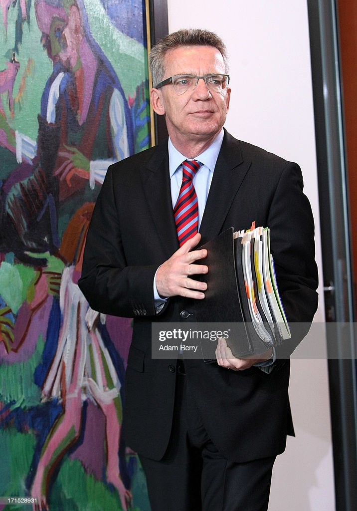 German Defense Minister <a gi-track='captionPersonalityLinkClicked' href=/galleries/search?phrase=Thomas+de+Maiziere&family=editorial&specificpeople=618845 ng-click='$event.stopPropagation()'>Thomas de Maiziere</a> arrives for the weekly German federal Cabinet meeting on June 26, 2013 in Berlin, Germany. High on the morning's agenda was discussion of the country's 2014 federal budget.