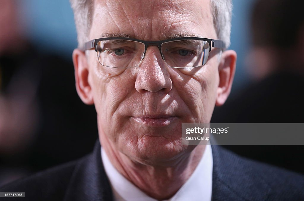 German Defense Minister <a gi-track='captionPersonalityLinkClicked' href=/galleries/search?phrase=Thomas+de+Maiziere&family=editorial&specificpeople=618845 ng-click='$event.stopPropagation()'>Thomas de Maiziere</a> arrives the weekly German government cabinet meeting on December 6, 2012 in Berlin, Germany. The German and Israeli governments are meeting later in the day for German-Israeli government consultations.