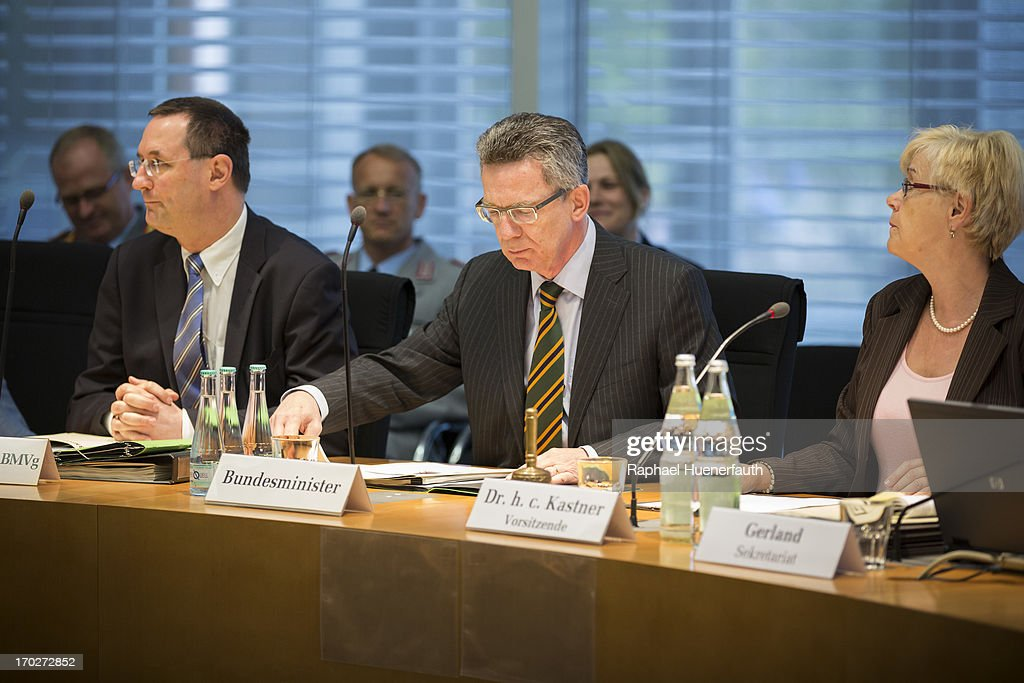 German Defense Minister Thomas de Maiziere (C) joins committee chairperson Susanne Kastner (R) to answer questions from parliamentarians at the Bundestag defense commission on June 10, 2013 in Berlin, Germany. De Maiziere is under increasing pressure following the 'EuroHawk' drone debacle, in which de Maiziere announced recently that the German government would cancel the military project, which has already consumed EUR 562 million, due to the complications with domestic flight certification. The 'EuroHawk' is a modified version of the Northrop Grumman RQ-4 Global Hawk.