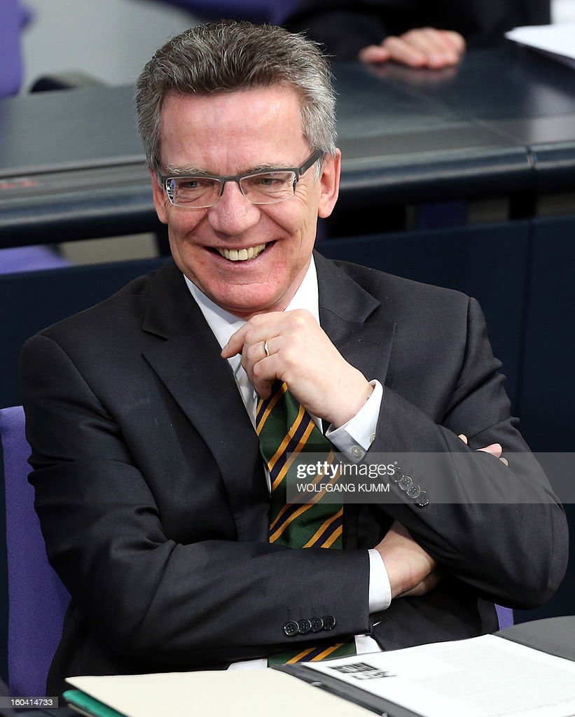 German Defense Minister Thomas de Maiziere reacts as he attends a session of the German Bundestag (lower house of parliament) in Berlin, Germany, on January 31 2013, to vote on the extension of the ISAF Afghanistan mission of the German Armed Forces. The Bundestag voted overwhelmingly to extend the country's military presence in Afghanistan but aimed to slash troop numbers to 3,300 by February 2014. AFP PHOTO / WOLFGANG KUMM GERMANY OUT