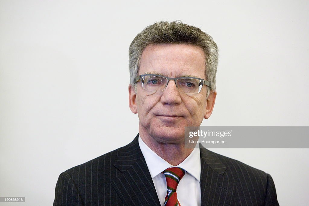 German Defense Minister <a gi-track='captionPersonalityLinkClicked' href=/galleries/search?phrase=Thomas+de+Maiziere&family=editorial&specificpeople=618845 ng-click='$event.stopPropagation()'>Thomas de Maiziere</a> speaks to the media as he visits the German Military Counter-Intelligence Service (MAD) on February 6, 2013 in Cologne, Germany. Defense Minister <a gi-track='captionPersonalityLinkClicked' href=/galleries/search?phrase=Thomas+de+Maiziere&family=editorial&specificpeople=618845 ng-click='$event.stopPropagation()'>Thomas de Maiziere</a> has rejected calls to shut down the Counter-Intelligence Agency despite fierce criticism from Ministers, following an investigation carried out by the Bundestag, for withholding information surrounding their recruitment of the NSU neo-Nazi terrorist Uwe Mundlos.