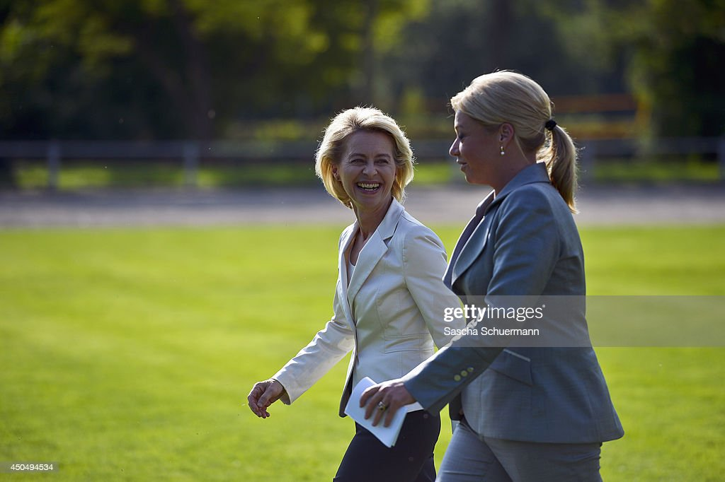 German Defense Minister <a gi-track='captionPersonalityLinkClicked' href=/galleries/search?phrase=Ursula+von+der+Leyen&family=editorial&specificpeople=4249207 ng-click='$event.stopPropagation()'>Ursula von der Leyen</a> and Dutch Defense Minister <a gi-track='captionPersonalityLinkClicked' href=/galleries/search?phrase=Jeanine+Hennis-Plasschaert&family=editorial&specificpeople=4314790 ng-click='$event.stopPropagation()'>Jeanine Hennis-Plasschaert</a> review Dutch and German troops at an event marking the integration of Dutch forces into the Division Schnelle Kraefte (DSK), or Rapid Forces Division, on June 12, 2014 in Stadtallendorf, Germany. The Dutch 11th Air Mobile Brigade will be under German command in the DSK, which is unit of the German military and is the successor to the Division Spezielle Operationen (DSO), or Special Operations Division.