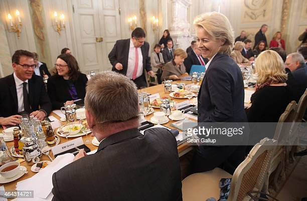 German Defense Minister Ursula von der Leyen and other cabinet ministers arrive the first meeting of the German government cabinet on January 22 2014...