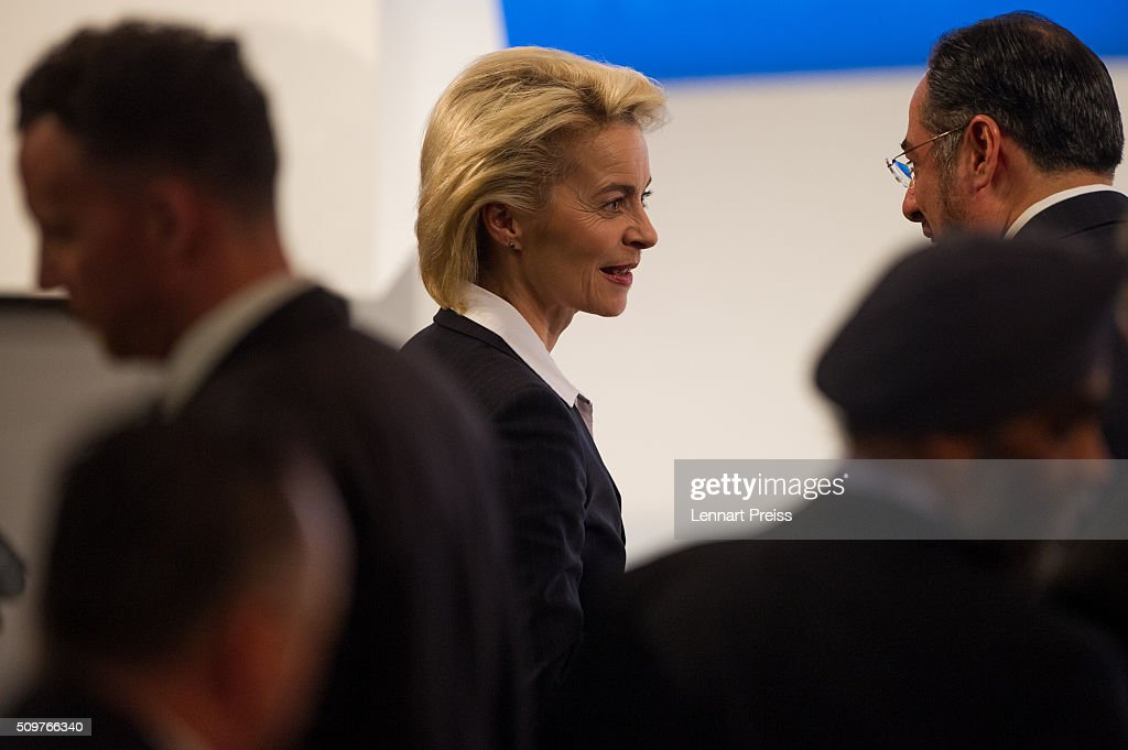 German Defense Minister Ursula von der Leyen (C) arrives at the 2016 Munich Security Conference at the Bayerischer Hof hotel on February 12, 2016 in Munich, Germany. The annual event brings together government representatives and security experts from across the globe and this year the conflict in Syria will be the main issue under discussion.