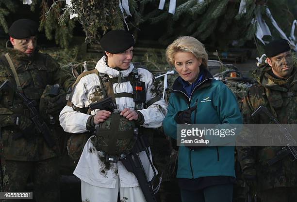 German Defense Minister Ursula von der Leyen chats with members including one female soldier of Panzerbataillon 413 which has served in Afghanistan...
