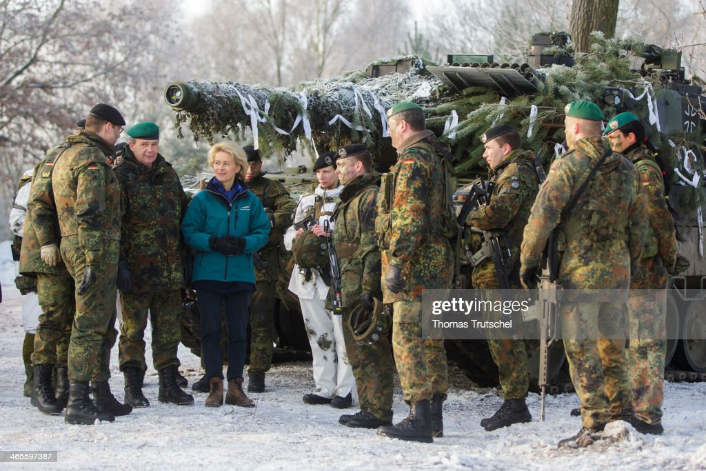 German Defense Minister <a gi-track='captionPersonalityLinkClicked' href=/galleries/search?phrase=Ursula+von+der+Leyen&family=editorial&specificpeople=4249207 ng-click='$event.stopPropagation()'>Ursula von der Leyen</a> chats with members, including one female soldier, of Panzerbataillon 413, which has served in Afghanistan, at the Bundeswehr combat training center during exercises on January 28, 2014 in Letzlingen, Germany. Von der Leyen has stated she aims to see the Bundeswehr participate more with other European troops in foreign peacekeeping missions.