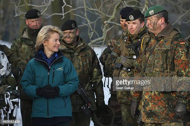 German Defense Minister Ursula von der Leyen chats with soldiers of Panzerbataillon 413 which has served in Afghanistan at the Bundeswehr combat...