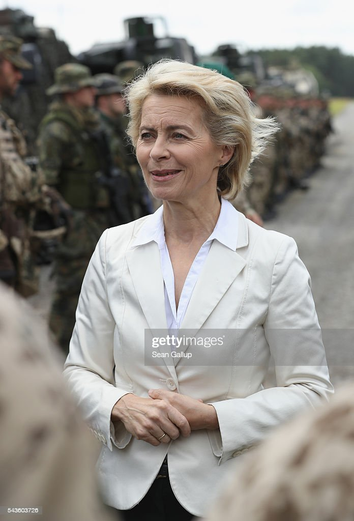 German Defense Minister Ursula von der Leyen chats with soldiers of the Bundeswehr, the German armed forces, following a demonstration of capabilities of Panzergranadierbataillon 33 of the 1st Panzer Division (1. Panzerdivision) that included the new Puma infantry fighting vehicle on June 29, 2016 near Neustadt am Ruebenberge, Germany. The Bundeswehr is aquirung the Puma in phases and the vehicle replaces the Marder.