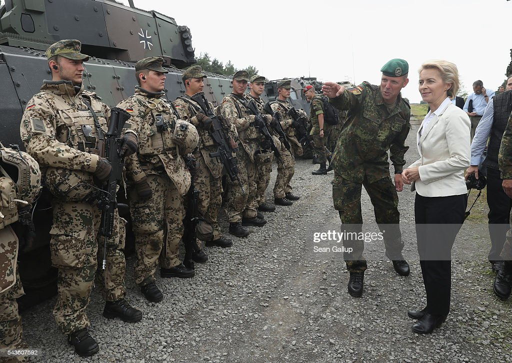 German Defense Minister <a gi-track='captionPersonalityLinkClicked' href=/galleries/search?phrase=Ursula+von+der+Leyen&family=editorial&specificpeople=4249207 ng-click='$event.stopPropagation()'>Ursula von der Leyen</a> chats with soldiers of the Bundeswehr, the German armed forces, following a demonstration of capabilities of Panzergranadierbataillon 33 of the 1st Panzer Division (1. Panzerdivision) that included the new Puma infantry fighting vehicle on June 29, 2016 near Neustadt am Ruebenberge, Germany. The Bundeswehr is aquirung the Puma in phases and the vehicle replaces the Marder.