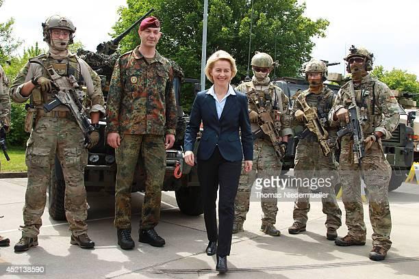 German Defense Minister Ursula von der Leyen looks on as troops of the elite KSK unit demonstrate their skills at a Bundeswehr base on July 14 2014...