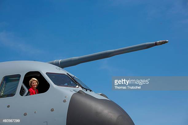 German Defense Minister Ursula von der Leyen looks out of the cockpit of an Airbus A400M during her visit of the ILA 2014 Berlin Air Show on May 21...