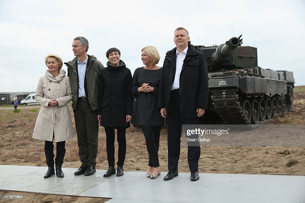 German Defense Minister <a gi-track='captionPersonalityLinkClicked' href=/galleries/search?phrase=Ursula+von+der+Leyen&family=editorial&specificpeople=4249207 ng-click='$event.stopPropagation()'>Ursula von der Leyen</a>, NATO Secretary General <a gi-track='captionPersonalityLinkClicked' href=/galleries/search?phrase=Jens+Stoltenberg&family=editorial&specificpeople=558620 ng-click='$event.stopPropagation()'>Jens Stoltenberg</a>, Norwegian Defense Minister Ine Marie Eriksen Soreide, Dutch Defense Minister Jeanine Hennis Plasschaert and Polish Defense Minister <a gi-track='captionPersonalityLinkClicked' href=/galleries/search?phrase=Tomasz+Siemoniak&family=editorial&specificpeople=8840145 ng-click='$event.stopPropagation()'>Tomasz Siemoniak</a> stand in front of a Leopard 2 tank of the Polish Army as they attend the NATO Noble Jump military exercises of the VJTF forces on June 18, 2015 in Zagan, Poland. The VJTF, the Very High Readiness Joint Task Force, is NATO's response to Russia's annexation of Crimea and the conflict in eastern Ukraine. Troops from Germany, Norway, Belgium, Poland, Czech Republic, Lithuania and Belgium were among those taking part today.