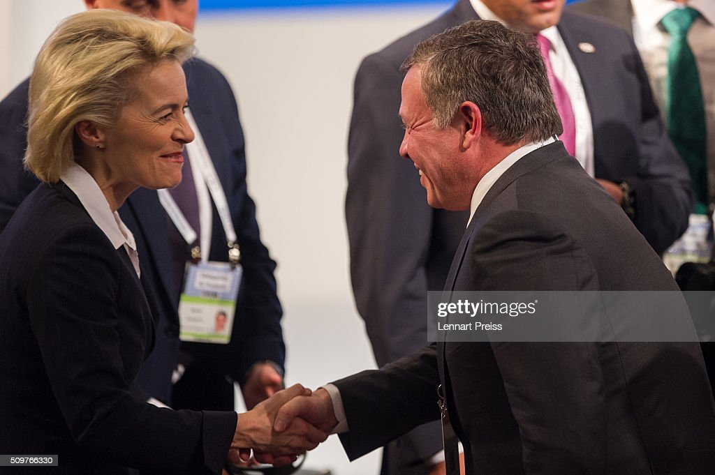 German Defense Minister Ursula von der Leyen shakes hands with King Abdullah II bin Al Hussein of Jordan at the 2016 Munich Security Conference at the Bayerischer Hof hotel on February 12, 2016 in Munich, Germany. The annual event brings together government representatives and security experts from across the globe and this year the conflict in Syria will be the main issue under discussion.
