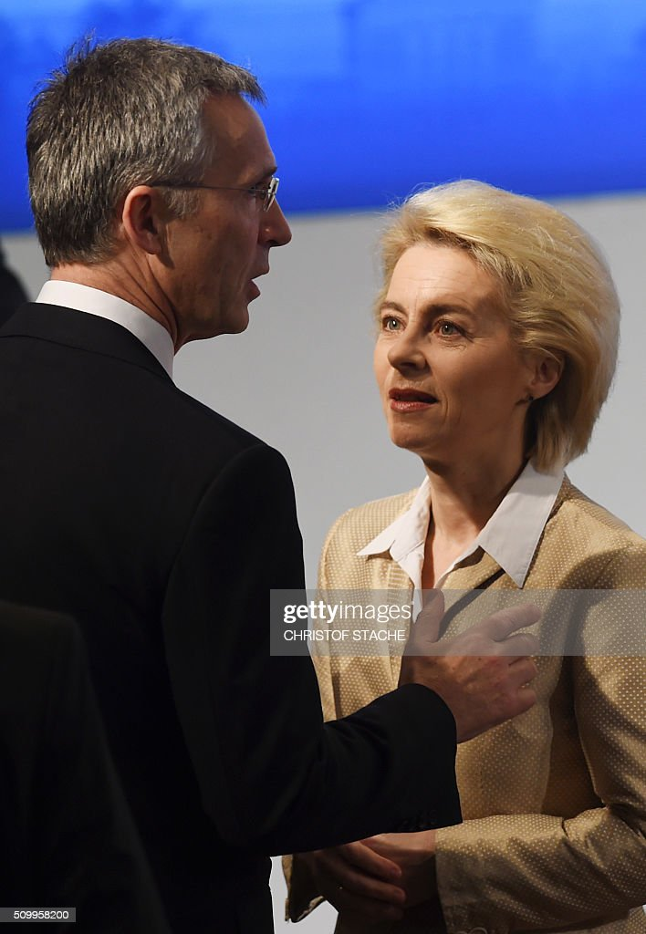 German Defense Minister Ursula von der Leyen (R) speaks with NATO Secretary General Jens Stoltenberg (L) ahead the start of the second day of the 52nd Munich Security Conference (MSC) in Munich, southern Germany, on February 13, 2016. / AFP / Christof STACHE