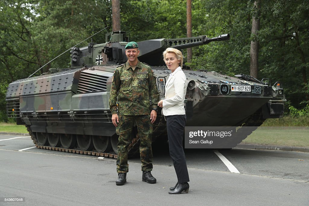 German Defense Minister <a gi-track='captionPersonalityLinkClicked' href=/galleries/search?phrase=Ursula+von+der+Leyen&family=editorial&specificpeople=4249207 ng-click='$event.stopPropagation()'>Ursula von der Leyen</a> stands next to a Puma infantry fighting vehicle of the Bundeswehr, the German armed forces, prior to a demonstration of capablities of Panzergranadierbataillon 33 of the 1st Panzer Division (1. Panzerdivision) on June 29, 2016 near Neustadt am Ruebenberge, Germany. The Bundeswehr is aquirung the Puma in phases and the vehicle replaces the Marder.