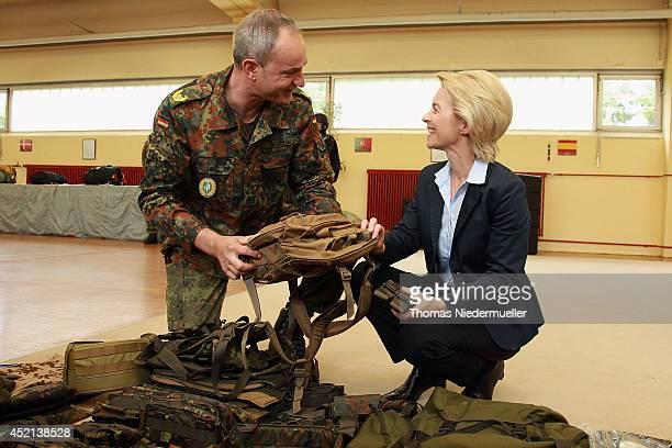 German Defense Minister Ursula von der Leyen talks to brigadier commander of KSK Dag Baehr during the elite KSK unit demonstrate their skills at a...
