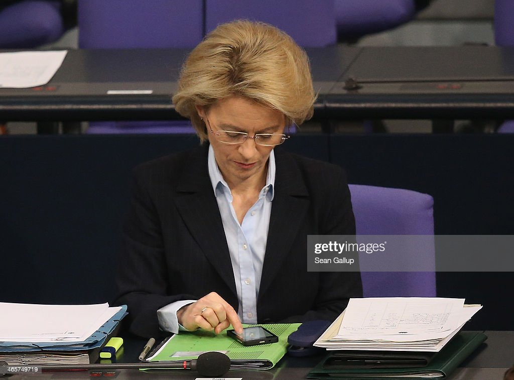 German Defense Minister <a gi-track='captionPersonalityLinkClicked' href=/galleries/search?phrase=Ursula+von+der+Leyen&family=editorial&specificpeople=4249207 ng-click='$event.stopPropagation()'>Ursula von der Leyen</a> taps on a smartphone as she attends debates at the Bundestag following a government declaration given by German Chancellor Angela Merkel, in which she outlined the policy priorities of the new German coalition government of Christian Democrats and Social Democrats, on January 29, 2104 in Berlin, Germany. The new government was sworn in in December and has a strong majority in the Bundestag to push through legislation.