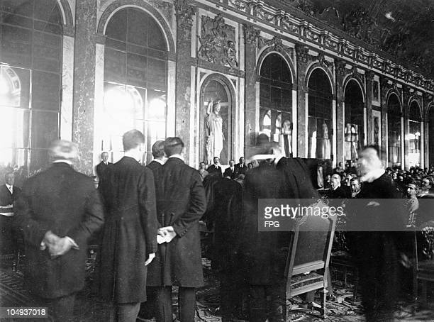German delegates signing the Peace Treaty at the historic table in the hall of mirrors in Versailles France on June 28 1919