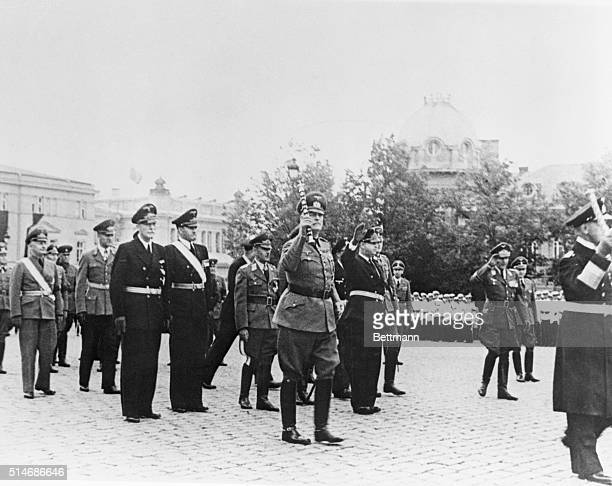German delegation in the procession at the funeral of King Boris Admiral Raeder to right with raised arm Marshall Keitel behind with raised baton...