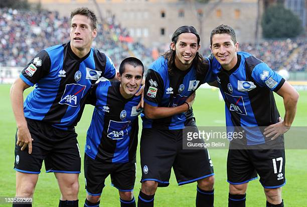 German Denis Maximiliano Morales Ezequiel Schelotto and Carlos Carmona of Atalanta celebrate a goal during the Serie A match between AC Siena and...