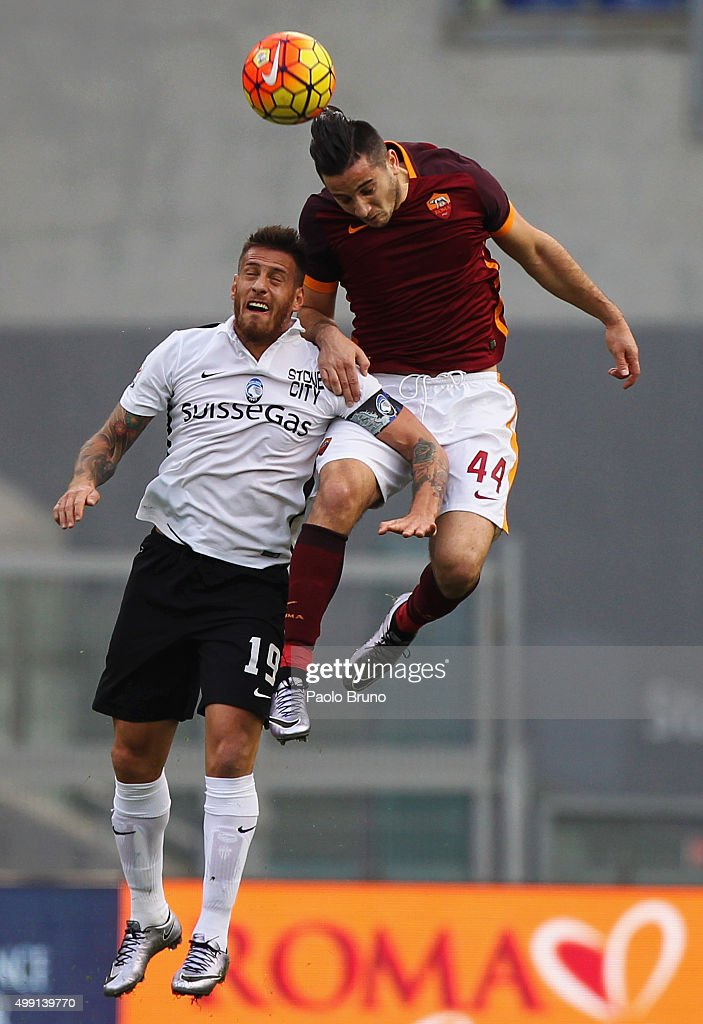 German Denis (L) of Atalanta BC competes for the ball with Kostas Manolas of AS Roma during the Serie A match between AS Roma and Atalanta BC at Stadio Olimpico on November 29, 2015 in Rome, Italy.