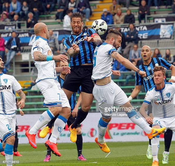 German Denis of Atalanta competes for the ball in air with Lorenzo Tonelli of Empoli during the Serie A match between Atalanta BC and Empoli FC at...